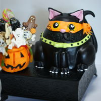 Halloween Cat Chocolate cake filled w/Caramel SMBC & Choc. Ganache. Pumpkin is rice crispy treat filled with candy as a extra treat for the Trick or...