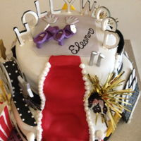 Hollywood Red Carpet Tiered cake with fondant and a few purchased gold pompoms with a fondant popcorn box - added popcorn at the event to complete the look....