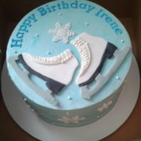 Ice Skates   Chocolate cake with coffee filling and vanilla SMBC icing. Skates and snowflakes made of MMF.