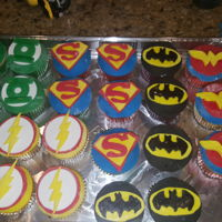 Justice League Cake And Cupcakes 4 tier cake and 3 dozen cupcakes