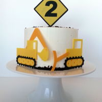 Kids Construction Equipment Birthday Cake   Made this for my granddaughter. Cut the decorations using my Cricut.