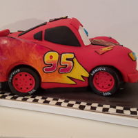 Lightning Mcqueen Car Cake I made this cake form my nephew's birthday. it is simple chocolate cake filled with buttercream cheese cream, covered with red fondant...