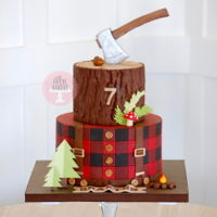 Lumberjack Cake Based on Lizzo Marek's Sugar Geek Show tutorial, this cake has plaid inside and out. The top tier uses a bark impression mat, and the...