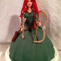 Merida Cake Tutorial I used a regular barbie doll and cut her hair, to be able to make hair in gumpaste in a reddish color.