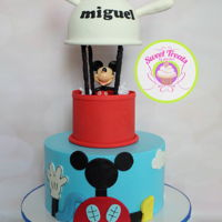 Mickey Mouse Clubhouse   This is a Mickey Mouse Clubhouse cake for a little boy. The toy was supplied by the client.