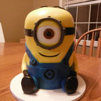 Minion Birthday Cake   6 inch rounds stacked and carved into a minion. Fondant covered with fondant accents.