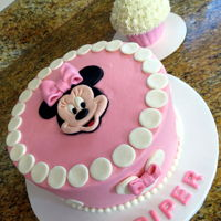 Minnie Mouse   Carrot cake with crusting cream cheese frosting and fondant decorations and a smash cake.