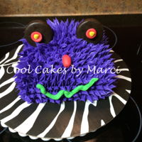 "Monster Cake 6x6 cake with spikes of butter cream frosting for ""fur"" and a fondant nose. Thin mint cookies for eyes. The cake was for a cake..."