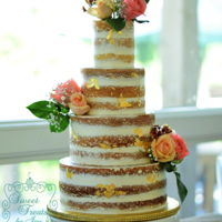 Naked Wedding   Naked cake with edible gold leaf and fresh flowers