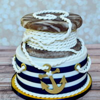 Navy Stripes  Bottom tier is covered in fondant and the stripes were painted to give them a richer blue. The rope spool is cake, except for the faux wood...