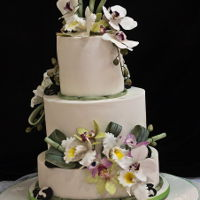 Oriental Wedding Cake White Wedding cake with Orchids, Bamboo and pebles