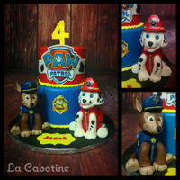 Paw Patrol Paw patrol cake, handmade caracter, Rice krispies treat and gumpaste.