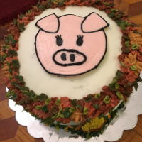Pig Pickin' Party Cake! Three layer carrot cake filled and decorated with cream cheese frosting. Piggy face is a frozen transfer.