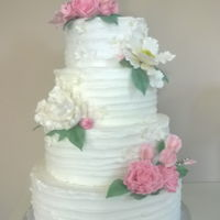 Pink And White Buttercream Wedding Cake. Tiers are lemon cake with strawberry white chocolate ganache, pumpkin cake with dark chocolate ganache, chocolate cake with salted caramel...