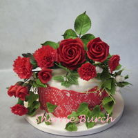 Red Roses, Carnations, Lace Cake Mbalaska red roses, red carnations, red cake lace, white fondant, devils food cake.