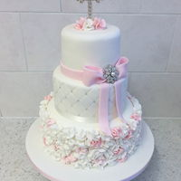 Ruffle Christening Cake Pink & white ruffles, quilted with Swarovski crystals & a diamanté cross & brooch.