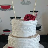 Rustic Wedding Cake Frilled wedding cake in a rustic design with a Mr and Mrs bunting banner and sugarpaste roses