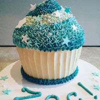 Smash! Giant cupcake for a little boy's 1st birthday smash