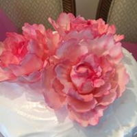 Success The First Time! This is a white cake with lemon curd filling and a marshmallow frosting. I made three gum paste peonies and just had a blast!