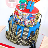 Superhero Cake A superhero cake for a four year old. I used Evil Cake Genius stencils for the skyline and the 'BAM' 'POW' and '...