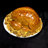 Thanksgiving Turkey My client asked me to make her a cake for her Thanksgiving dinner and told me to surprise her...so this is what I decided to do :) Red...
