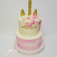 Unicorn 1St Birthday Cake Client wanted something with a unicorn, girly and pink, I came with this design. Buttercream 6in,8in, I did a watercolor buttercream...