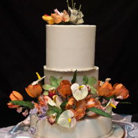 White Wedding Cake With Tulips Fondant with various Tulips and Anthuriums
