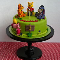 Winnie The Pooh The cake with chocolate cream and marzipan.