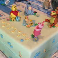 Winnie The Pooh Baby Shower Apple Pie Cake with vanilla b/c and Massimo fondant. All figures hand made with gum paste.
