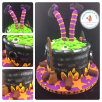 Witch In Her Cauldron Orange cake with caramel filling, covered and decorated with fondant. Legs are gumpaste and well as the broom.