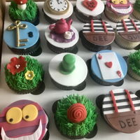 Alice In Wonderland Made these cupcakes for an Alice in Wonderland themed baby shower along with a small cake.