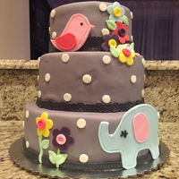 Baby Shower Cake Three tier fondant covered cake. Fondant polka dots, elephant, bird, and flowers.