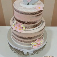 Christening Semi Naked Cake Christening semi naked cake for girl decorated with fondant flowers and a little cute elephant topper