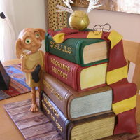 Dobby Harry Potter Cake Dobby is free!! ..... This 4 tier Harry Potter book cake featuring a hand sculpted Dobby (holding his sock of course!) was made for a 21st...