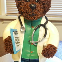 Dr. Bear My first standing cake. He stands 12 inches tall. Made out of chocolate cake (body) and cake pops (legs) covered with fondant.