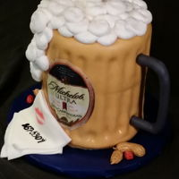"Drewski's Brewski 6"" cakes stacked and decorated to look like a beer mug. Note the phone number on the napkin....remember the song??"