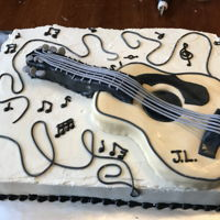 Guitar Fondant covered cake for the guitar.