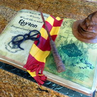 Harry Potter Cake   Fondant covered Harry Potter book cake with gumpaste wand and glasses and fondant covered sorting hat.