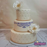 Ivory And Purple Wedding Cake Quilted 3 tier ivory and purple wedding cake with open gumpaste peonies and stencil detailing