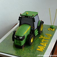John Deere The cake with raspberry cream.