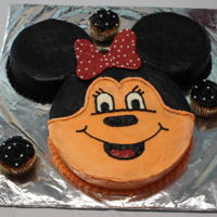 Minnie Mouse Cake buttercream frosting, chocolate bow with edible pearls