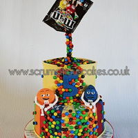 M&m Gravity Defying Cake Every year Mylo gets to choose his own cake, it's very different every year and this year he wanted M&M's! &...