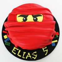 "Ninjago Cake Ninjago party with ""Kai"" as a cake. Visit my website for more pictures! :) http://rebeccastartor.blogspot.se"