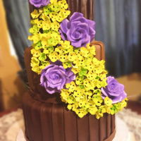 Pleated Chocolate Wedding Cake 3 Tier Pleated Chocolate Wedding cake with Gumpaste Roses and Hydrangeas