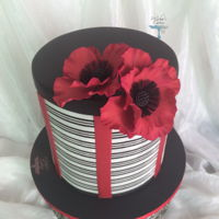 Poppies It was for a Fitness center opening ceremony ,inspired from the center's colors . Gum paste poppies, white royal icing ,molly cake ,...