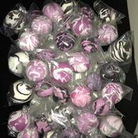 Purple Marbled Cake Pops Yellow cake covered in purple candy with white or black drizzle.