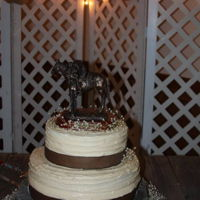 Rustic Wedding Cake Round wedding cake with cowboy topper