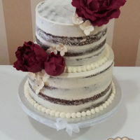 Semi Naked Wedding Cake Semi naked wedding cake decorated with burgundy fondant peonies