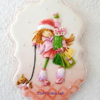 Some Christmas Shopping! A coloured royal icing decorated cookie.