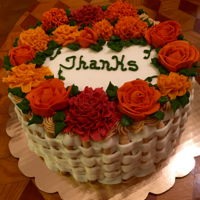 Thanks Carrot Cake Three-layer carrot cake frosted and decorated with cream cheese frosting.